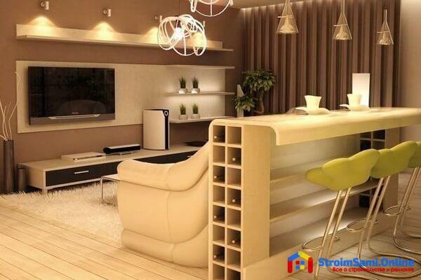 На фото: кухня, разделенная с гостиной барной стойкой