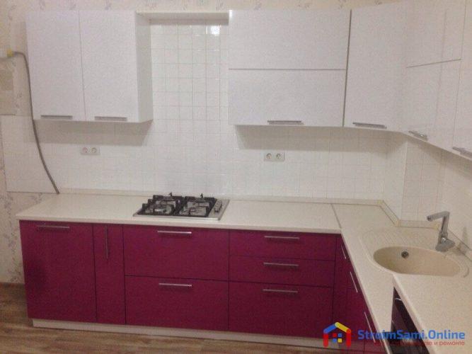 На фото: акриловая кухня и варочная панель