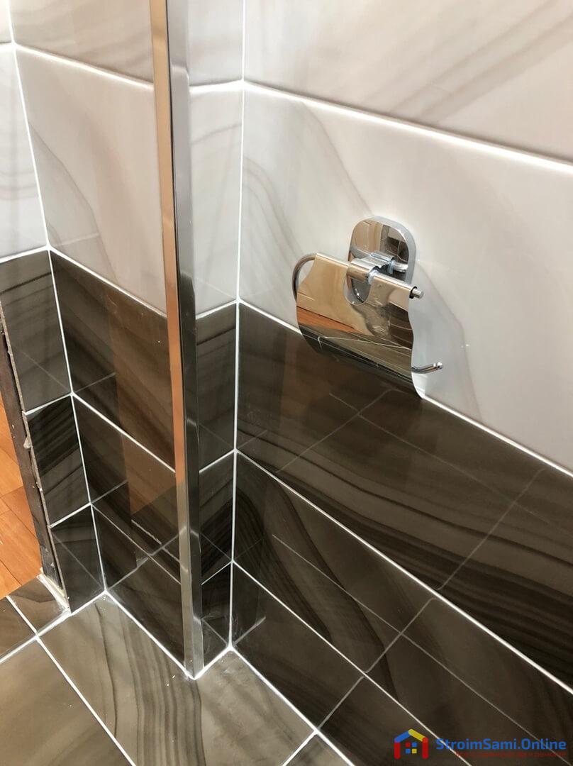 На фото: держатель для туалетной бумаги настенный металлический