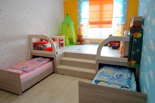 На фото: дизайн детской комнаты для двух разнополых детей