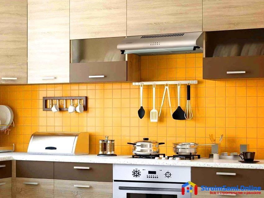 На фото: Вытяжка для кухни с отводом в вентиляцию