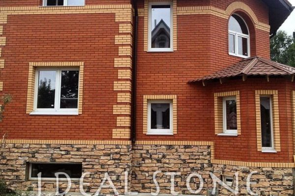 Отделка фасада дома искусственным облицовочным камнем