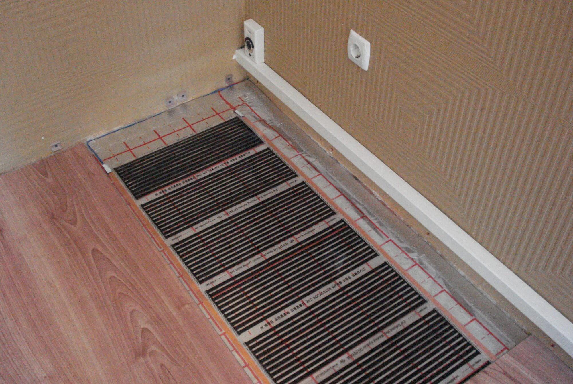 На фото: электрический теплый пол
